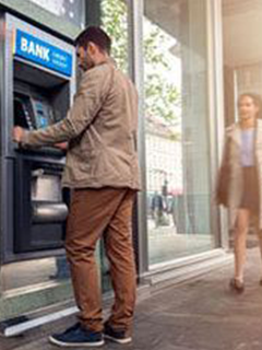 person at atm
